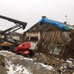 Démolition d'une maison brulée